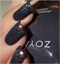 The Polished Perfectionist:      I applied two coats of Kelly from Zoya. Then I sponged half of the nail with Speciallità - Hefesto, an amazing prismatic top coat. For some extra bling I also added Blair from Essence on the tips.