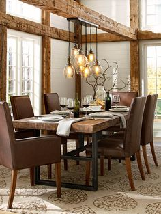 Love this new chandelier and wood beams! Would work with my benchwright table! #potterybarn