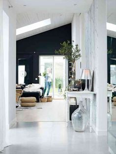 Make a statement with a black wall next to stark white