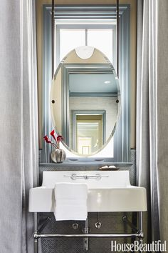 tiny Bathroom Decor Use your windows. In an Atlanta family home, the downstairs bathroom had virtually no walls to hang a mirror from. No problem: Just hang your mirror in front of the window, which creates privacy with a purpose. Bathroom Window Curtains, Bathroom Windows, Bathroom Mirrors, Small Bathroom Window, Bathroom Furniture Design, Bathroom Design Small, Small Bathrooms, Modern Bathrooms, Small Kitchens