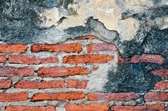 Stock image of 'Old weathered brick wall fragment'