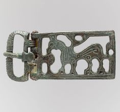 """Title: Belt Buckle with a Griffin- second half 6th century- Made in Burgundy- Frankish- Copper alloy, """"tinned"""" surface"""