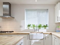 simple white and wood kitchen