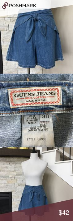 Vintage Guess Jeans skort (skirt/shorts) chambray Excellent condition Guess skirt/shorts/skort with tie waist. Slight pulling at seam in one small area, but this is concealed by the tied knot in front Guess Shorts Jean Shorts