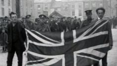Two Irish civilians forced to parade around a Waterford town by British troops with a British flag tied around their necks. Both men were beaten and dumped outside the town. The War of Independence, Ireland, 1920 #TheTroubles
