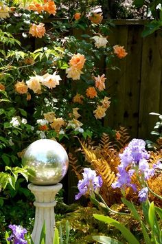 Gazing balls are a popular garden embellishment for the rainbow of colors they… Front House Landscaping, Outdoor Landscaping, Outdoor Gardens, Outdoor Decor, Outdoor Ideas, Landscaping Ideas, Backyard Ideas, Outdoor Spaces, Garden Ideas