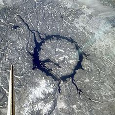 Want to feel small and young? Just contemplate the size and sheer ancientness of the Manicouagan Crater