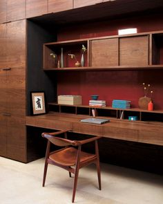 The home office, outside the media room, has a built-in desk and cabinetry of continuous-grain walnut.
