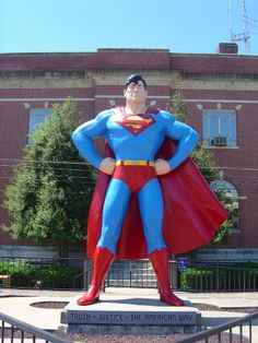 Drive the thousands of miles  find yourself in Metropolis Illinois  standing before a statue of Superman    Ask the lady at the convenience store  what she thinks  and she will tell you  she is angry.    Go to the Museum, and remember  it is important to believe   in heroes.    Smile at the lady, buy the candybar  and the lemonade, and say  Good day.