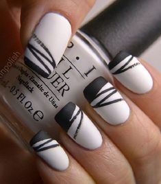 White nail color looks plain and boring. Make a fashion statement by adding black stripes!