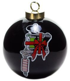 "SOURPUSS TATTOO MACHINE ORNAMENT - Zzzzzzappy Holidays! Our Tattoo Machine Ornament is a great way to add some flash to your Christmas tree this holiday season! The ceramic, 3"" ball features a festive, red and green tattoo machine on one side and a ""Happy Holidays"" banner-wrapped-heart on the other."
