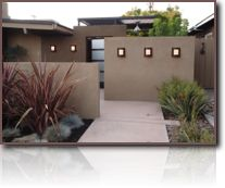 Mid-Century Modern Redo: Stepped and staggered walls lead to the entry door. Lights in the path and on the walls beckon. This door leads to an outdoor courtyard, with the house's front door in the courtyard.