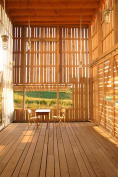 14 etc -- #4 Blair Barn, Wisconsin, Empire Development, Timber slatted screens provide welcome shade from the hot sun in the Blair Barn. The screen is also effective in reducing uncomfortable breezes. The tilt-out screen opens up the space to the views, while the mix of vertical and horizontal slats create interesting light and shade patterns inside.