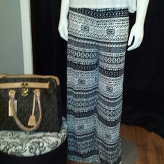 Polluza pants Black and white Aztec polluza pants thin flowy material super comfy for spring. Michael kors inspired bag also available in this closet. I have these pants in size large and extra large. Pants Wide Leg