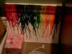 Color crayons stuck on canvas and melted, awesome idea for my daughter and me to do