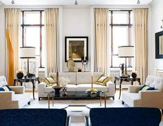 eclectic, symmetrical living room design with carefully edited pieces in a creamy palette