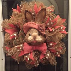 This gorgeous wreath is made of poly jute burlap deco mesh with metallic threads running throughout and plain poly jute burlap deco mesh. I then