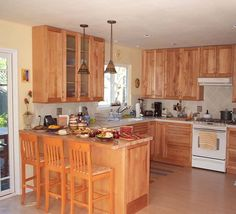 Kitchen Designs For Small Kitchens - Bing Images...move frig to garage wall...add bar where frig was...build pantry around frig...put table in area of the support wall. Maybe