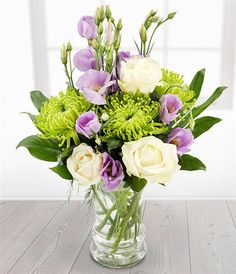 Candle Light Lovely lilac Lisianthus blooms with glorious green Chrysanthemums and creamy white Roses. Professionally arranged in a clear glass vase Amazing Flowers, Purple Flowers, Beautiful Flowers, Get Well Flowers, Vase Arrangements, Flower Arrangement, Small Centerpieces, Corporate Flowers, Clear Glass Vases
