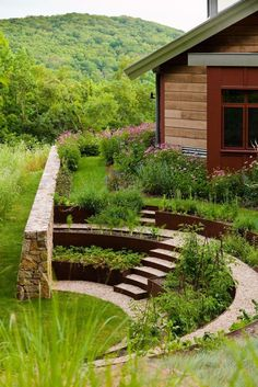 Fieldstone retaining walls wrap the herb and vegetable garden amphitheater at Iron Mountain House, and Cor-Ten steel bands filled with crushed stone create a stepped terrace. Sunken Garden, Sloped Garden, Terraced Vegetable Garden, Hillside Garden, Vegetable Bed, Garden Steps, Garden Bed, Fence Garden, Vegetable Gardening