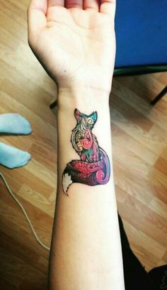 Colourful watercolour, tribal fox tattoo
