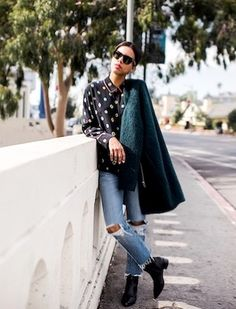 Black pajama patterned silk blouse+distressed denim+black ankle boots+emerald green felted coat+black sunglasses. Fall Everyday Outfit 2016