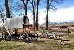 A covered wagon is among a large collection of historic, horse-drawn vehicles at Grant-Kohrs Ranch.