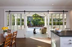 sliding doors to front porch and back patio- like the use of barn door style hardware by Nesli Er