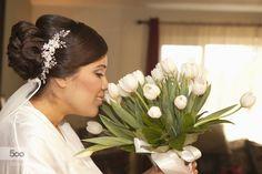 bridesheaven:  Hispanic bride smelling bouquet by gabledenims