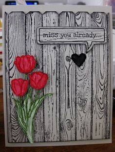 handmade card ...   great use of hardwood stamp to create a garden fence effect ... pretty red tulips pop out ... cute heart punched out  ... Stampin' Up!