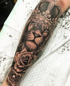 Lion tattoos hold different meanings. Lions are known to be proud and courageous creatures. So if you feel that you carry those same qualities in you, a lion tattoo would be an excellent match Lion Leg Tattoo, Lion Tattoo With Crown, Lion Forearm Tattoos, Lion Tattoo Sleeves, Lion Head Tattoos, Forarm Tattoos, Leg Tattoo Men, Best Sleeve Tattoos, Tattoo Sleeve Designs
