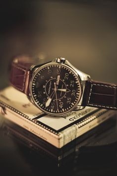 Khaki Pilot watch by Hamilton - looks like the watch worn by an early American pilot with its classic aviator design.
