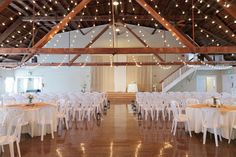 burlap and lace curtain backdrop with twinkle lights in barn wedding close to Salem Oregon