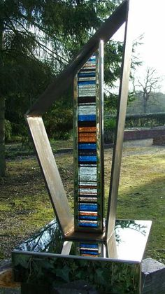 Stainless #steel. mild steel. Stained #glass #sculpture by #sculptor Jane Bohane titled: 'Transient II (Contemporary Glass Garden Art statue)'. #JaneBohane