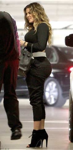 A figure many women envy: Khloe Kardashian showed off her generous backside as she talked to two valet attendants in Beverly Hills on Tuesday afternoon