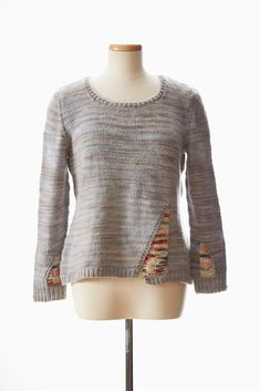 Lana Jois elevates a basic fitted pullover knitting pattern with intriguing insets worked using the intarsia method in her Pen and Ink Pullover.