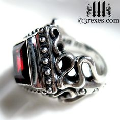 The Raven Love Silver Wedding Ring with 10mm large garnet stone (http://www.3rexes.com/raven-love-silver-wedding-ring/) #gothicrings