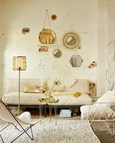 Creamy white living room with golden details and raw walls
