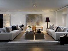 Idea living moderno di lusso, minimal, stile maschile. Perfetto anche per incontri d'affari amichevoli. Arredo con divani chiari e grande quadro centrale