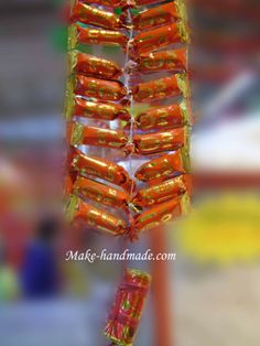 Chinese New Year crafts for kids: Firecrackers with candy