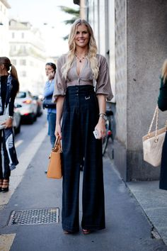 STREET STYLE SPRING 2013: MILAN FW - High-waisted trousers lead to legs for days.