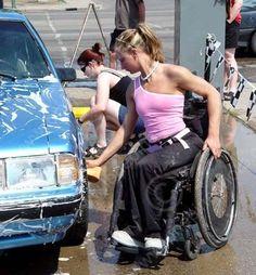 PEO ACT SUM SK CWN02T0084D NMR VT.GIRL IN WHEELCHAIR WASHING CAR.SASKATOON HILLTOPS CHEERLEADERS.SASKATOON 06\...© CLARENCE W. NORRIS ALL RIGHTS RESERVED.AUTOS;CAR_WASHES;CHEERLEADERS;DISABILITIES;FEMAL