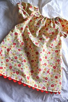 "Check out the blog, ""Sew Much Ado,"" for the free pattern of this baby peasant dress! I used a thrift store sheet for the fabric..."
