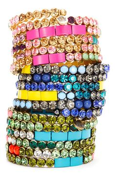 Juicy Couture 'Hard Core Couture' Rhinestone Coil Bracelets - A glamorous bracelet wraps the wrist with a colorful collection of smooth stones and sparkly jewels.