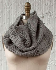 Free Knitting Pattern for Empalme Cowl - Sections of trinity stitch alternate with stockinette short row wedges. DK yarn. Designed by Cassandra Milani.