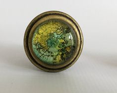 Wanderlust Map Drawer Pull / Map cabinet pull / yellow blue green cabinet pull / knob / hardware / dresser knob / drawer handle / hardware by MyFancyClutter on Etsy Cabinet And Drawer Knobs, Dresser Knobs, Drawer Handles, Drawer Pulls, Map Drawers, Shabby Chic Knobs, Glass Showcase, Green Cabinets, Custom Map
