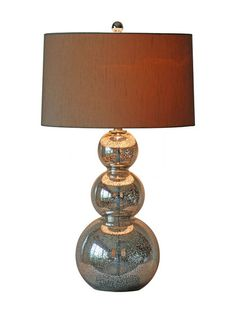 Just in case you can't afford it look at the DIY lamp with almost the same finish. Of course we know the difference. Beautiful! Glamorous Gourd Lamp by Surya at Gilt