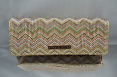 Buy one now only at €42.90.This exclusive handmade straw clutch bag is designed by us. The distinctive colorful funky straw weave zig-zag pattern makes the Straw Clutch stand out from the crowd day or night. Zig Zag Straw pattern is really the straw fashion for 2012! Check out for similar Zig Zag pattern high heel shoes and lovely dresses and tops & whalla! Grab one now, girls! Only at bagsjourney.com.
