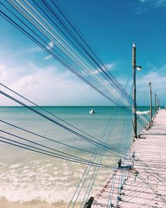 """Photo by @jessicasamplegram // Strung cords on a dock on the beautiful isla #holbox - like Tulum 15 years ago before it was """"discovered"""" by natgeotravel"""