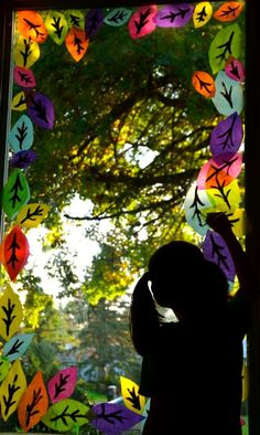 Decorate the windows for Fall  ( with kids made leaves )